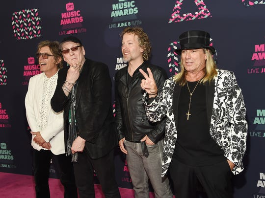 Cheap Trick's Tom Petersson, Rick Nielsen, Daxx Nielsen and Robin Zander attend the 2016 CMT Music Awards in Nashville.