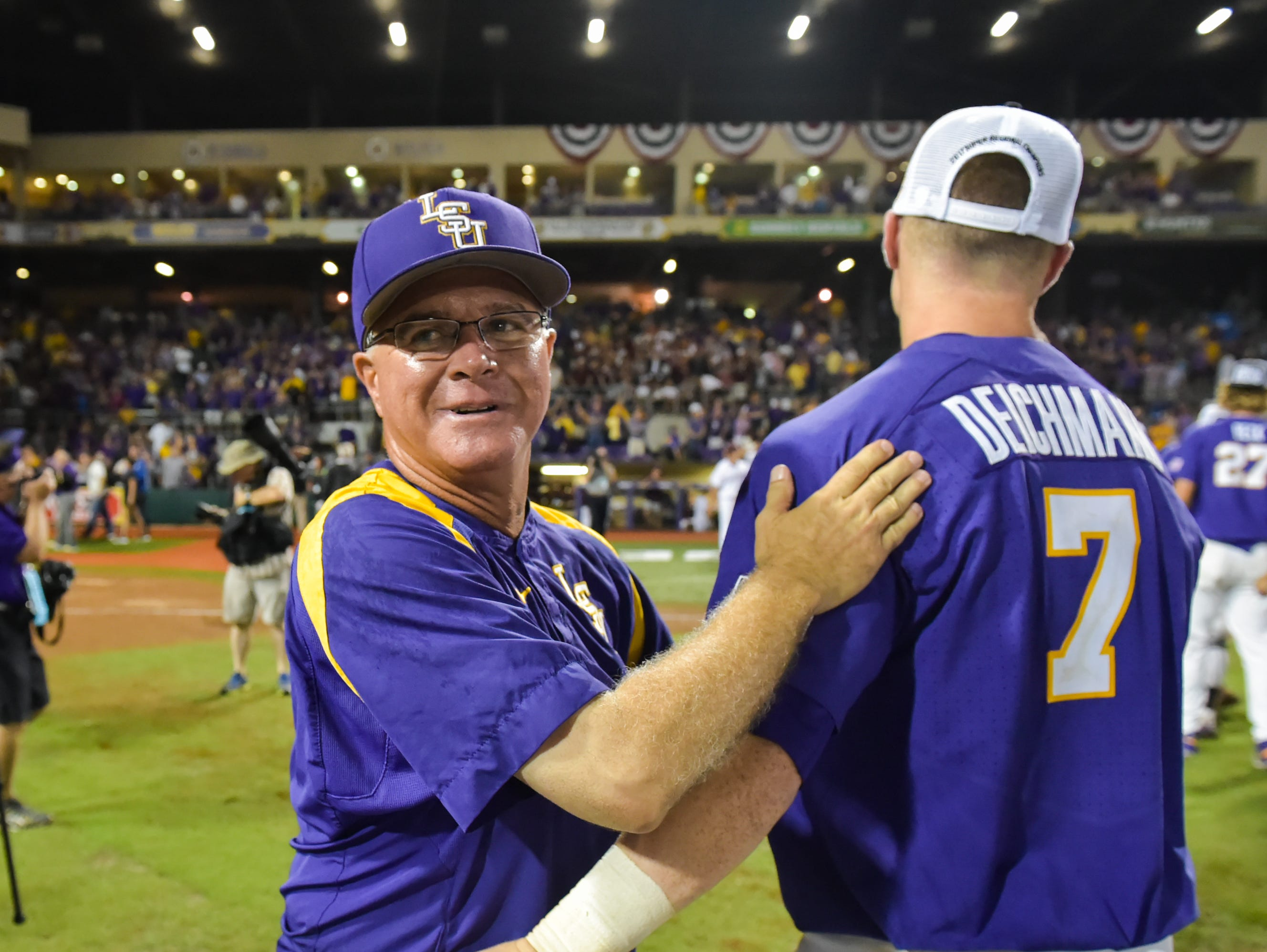 Paul Mainieri celebrates with players as LSU beats Mississippi State 14-4 in game 2 of the NCAA Super Regionals at Alex Box Stadium. - Sunday, June 11, 2017.