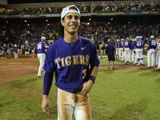 Kramer Robertson celebrates with teamates as LSU beats Mississippi State 14-4 in game 2 of the NCAA Super Regionals at Alex Box Stadium. - Sunday, June 11, 2017.