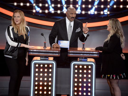 (L to R) Comedian Amy Schumer, show host Steve Harvey
