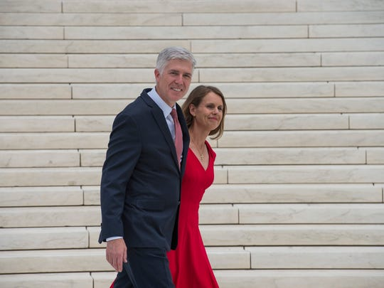 Justice Neil Gorsuch and his wife, Louise, pose for