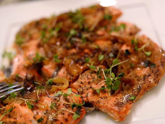 "Homemade salmon with caramelized onions and micro greens seen during ""Dinner with Your Muslim Neighbor"" on Sunday, June 11, 2017 at Amanda Saab's home in New Boston."