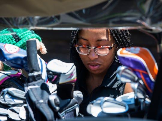 Kennedi Whitener, 16, of Fayetteville, N.C., packs