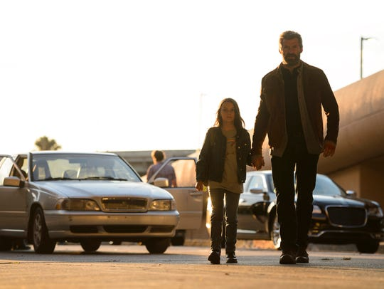 Laura (Dafne Keen, left) and Logan (Hugh Jackman) hit