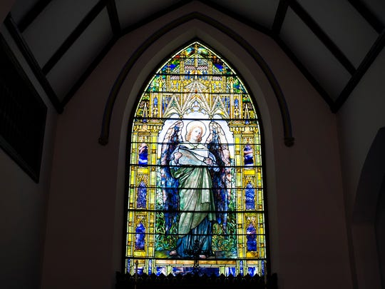 A Tiffany stained glass window was added to the chapel