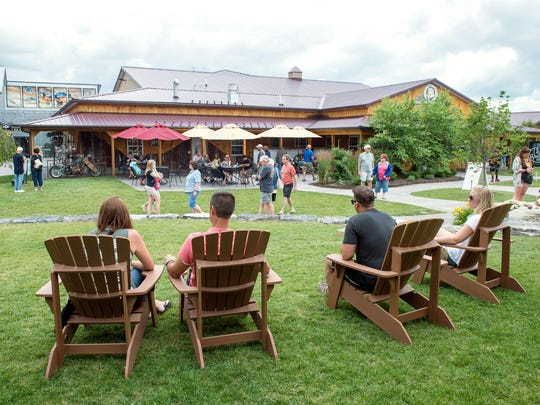 From left, Angela and Kevin Cloutier of Pittsburgh and Ryan Hill and Shannon McConnell, both of Altoona, Pennsylvania, lounge outdoors at Three Brothers Wineries and Estates in 2017.