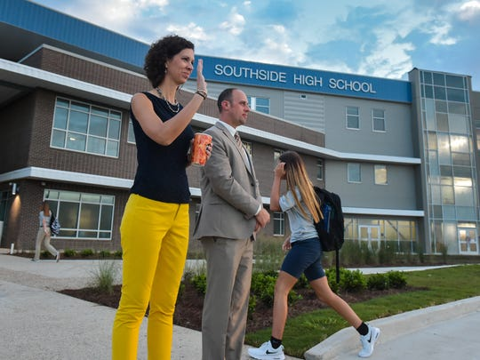 Southside High Principal Catherine Cassidy and Lafayette Parish School Board member Jeremy Hidalgo greet students who arrive at Southside High in 2017.