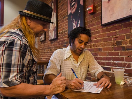 Ronnie Rue and Sami Parbhoo discuss the musicians scheduled to perform at Blue Monday at Jefferson Street Pub. Monday, Aug. 14, 2017.