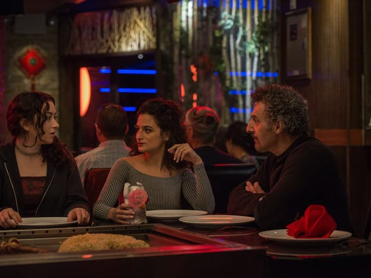 "Abby Quinn (from left), Jenny Slate and John Turturro share their feelings during a night out in ""Landline."""