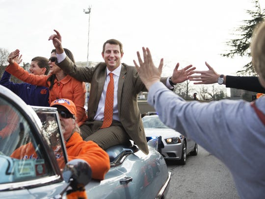 Dabo Swinney and family greet fans during a national