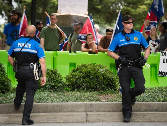 Greenville police monitor an anti-Confederate statue rally and a pro-Confederate statue counter-protest in downtown Greenville on Saturday, Aug. 26, 2017.