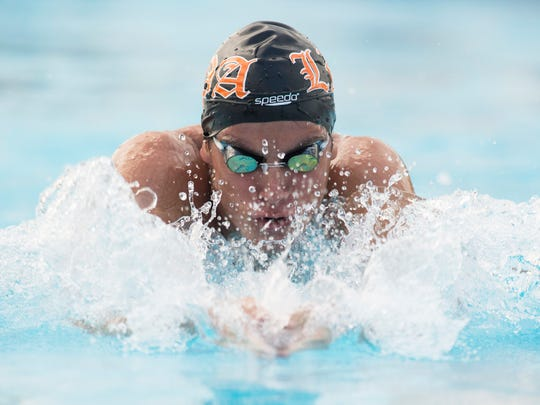 Lincoln Park Academy's Daniel Ochse swims the breaststroke leg of the medley relay during the high school swim/diving meet at Indian River State College on Wednesday, August 30, 2017, in Fort Pierce.