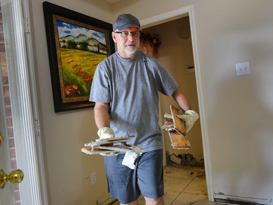 Tony Graham begins the cleanup process in his Friendswood,