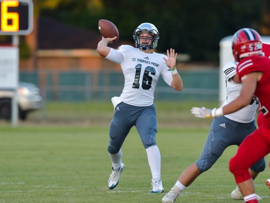 Quarterback Peyton Landry throws a pass as Comeaux