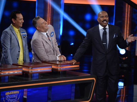"The families of multiplatinum Grammy Award-winning recording artist Faith Evans and television personality Ross Mathews compete during ""Celebrity Family Feud."" (L to R) Salvador Camarena, Mathews and host Steve Harvey.  This episode of ""Celebrity Family Feud"" airs Sept. 24 on ABC."