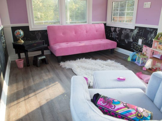 A pink futon accents the second floor of the playhouse