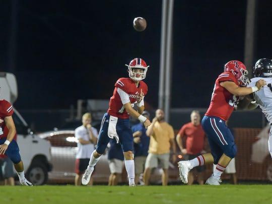 Quarterback Garrett Bergeron throws a pass as The Kaplan
