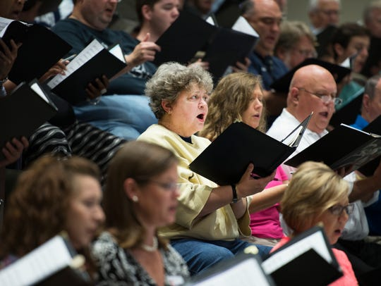 Members of the Greenville Chorale rehearse in Harper
