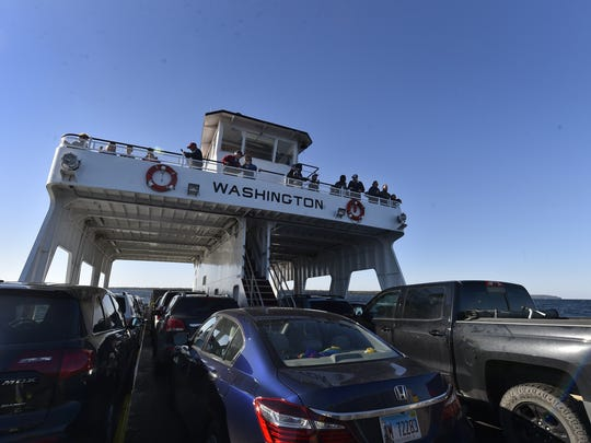 Passengers take in the view of the 30-minute ride from the top level enroute to Washington Island on Sunday, Oct. 8, 2017.
