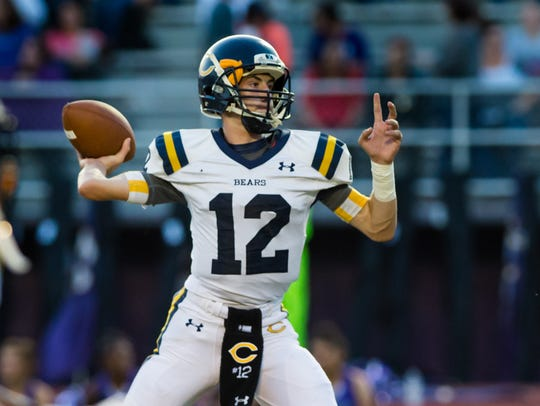 Bears quarterback Austen Breaux throws a pass as the Rayne Wolves take on the Carencro Bears. Thursday, Oct. 19, 2017.
