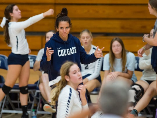 STM volleyball coach Jessica Burke cheers from the sideline during a match against Pope on Oct. 21.