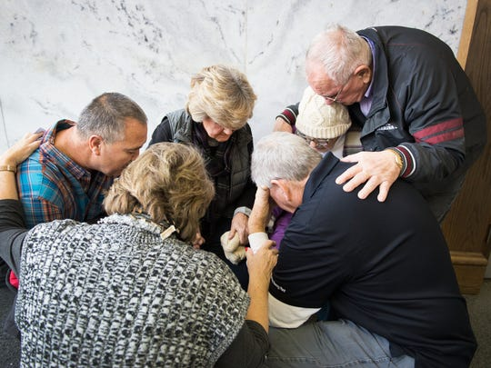 Regina Tague, mother of Todd Kohlhepp, prays with family members of Superbike Motorsports victims outside of the courtroom before a hearing for a lawsuit filed by Kayla Brown against Kohlhepp at Spartanburg County Courthouse on Thursday, January 5, 2017. Kohlhepp confessed to the 2003 murders of the four victims at Superbike Motorsports.