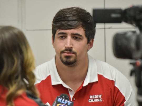 Offensive tackle Grant Horst, who'll help lead UL into Ole Miss on Saturday, speaks with a media member earlier this year.