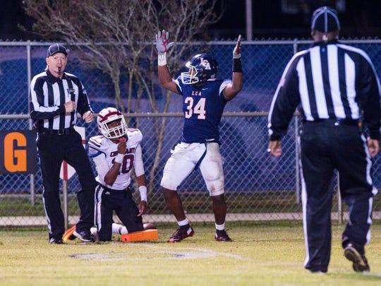 Logan Gabriel scores a touchdown as Lafayette Christian