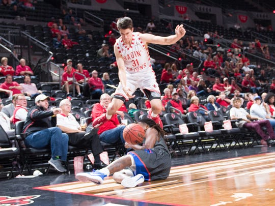UL's Mason Aucoin saves a ball from going out of bounds