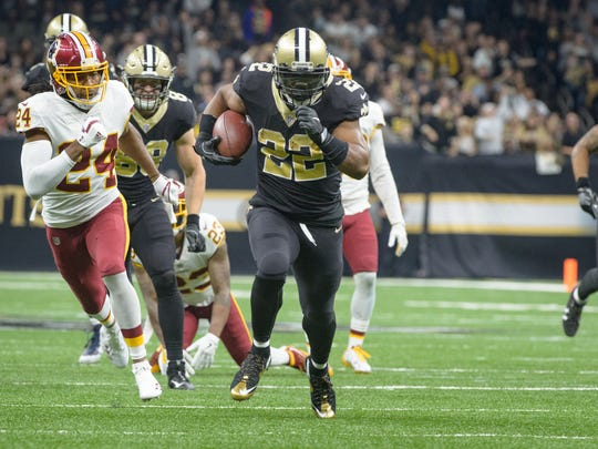 Saints runningback Mark Ingram runs the ball as The
