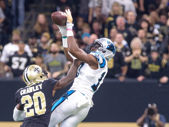 Saints carnerback Ken Crawley breaks up a pass to Panthers