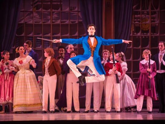 """Garrett Glassman gets airborne in """"The Nutcracker,"""" performed by Milwaukee Ballet."""
