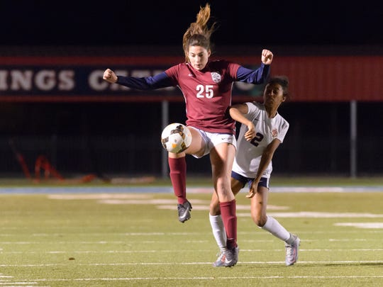 St. Thomas More's Caroline Morton (25) scored the dramatic game-tying goal in extra time for the Lady Cougars to earn a 2-2 tie with Teurlings Catholic on Tuesday.