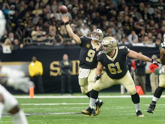 Saints quarterback Drew Brees throws a pass as The