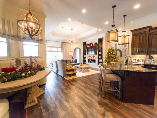 The kitchen area is open and features luxury furnishings.