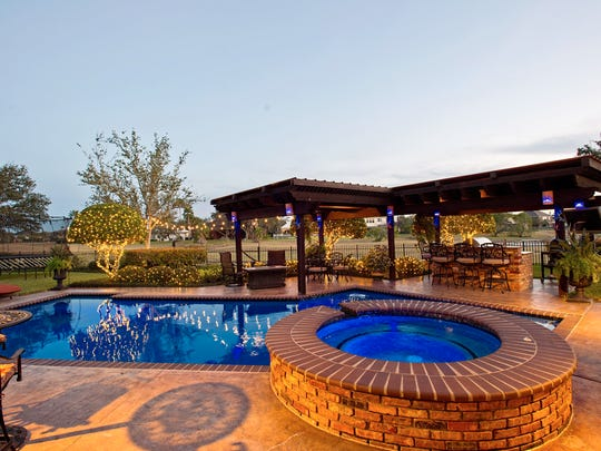 """The pool was  resurfaced with Òjewel scape"""" and a new  tile border that took it  from a dark bottom to an inviting brilliant blue."""