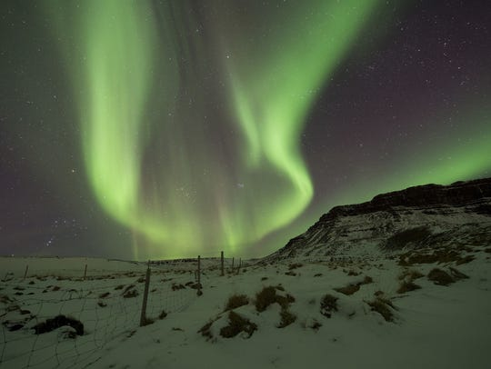 The Northern Lights, or aurora borealis, appear in