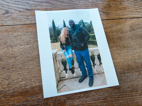 A picture of owner Jhan Beaullieu with basketball great Shaquille O'Neal at her home.