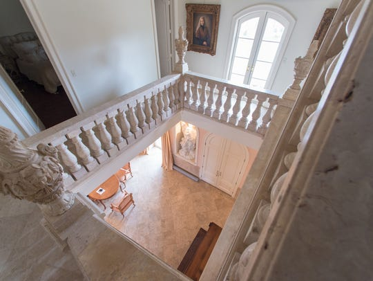 The grand staircase was designed by owner and is solid