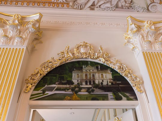 Much of the home's gold leaf detail was applied by