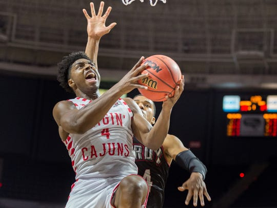 Frank Bartley drives to the basket Jan. 27 against Troy in the Cajundome.