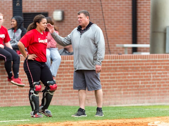 New UL softball coach Gerry Glasco talks with sophomore catcher/outfielder Beth Ashley during a recent intrasquad scrimmage.