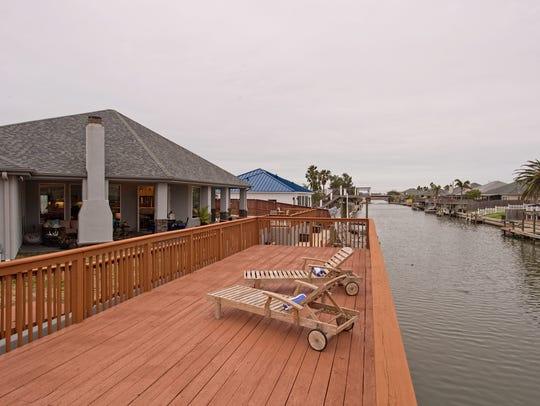 An upper level deck along a Padre Island canal has