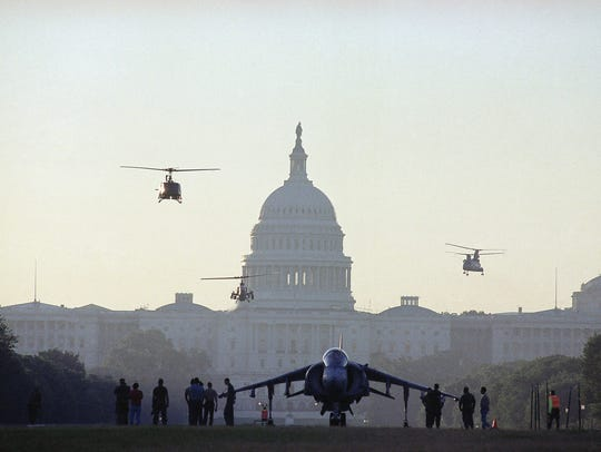 The last time Washington held a military parade was 1991, after the Gulf War ended. A group of helicopters arrive near a Harrier jet on Capitol Hill on June 7, 1991. The military hardware was on display ahead of the National Victory Celebration.