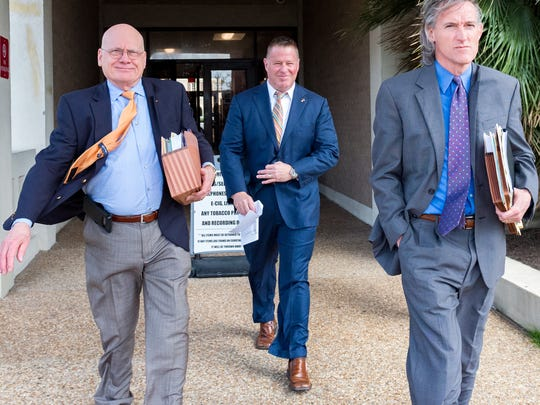 Lafayette City Marshall Brian Pope leaving the Lafayette Parish Courthouse. Tuesday, Feb. 20, 2018.