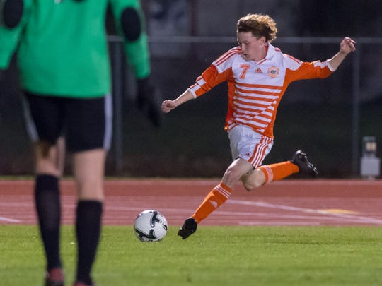 Landon Guidry takes a shot on goal as The Beau Chene Gators take on the Holy Cross Tigers in the LHSAA State Soccer Championship. Thursday, Feb. 22, 2018.
