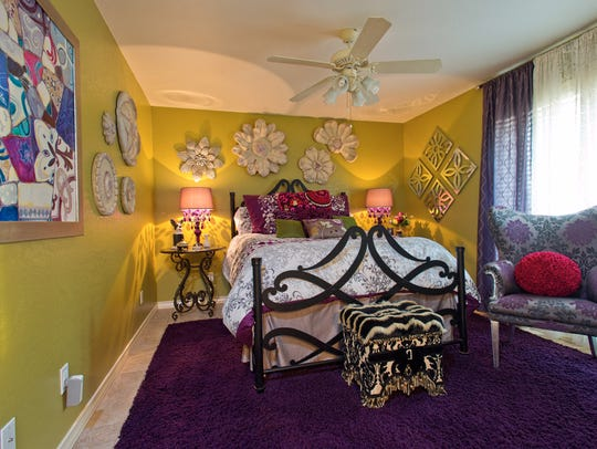 A colorful guest bedroom takes in the warm afternoon
