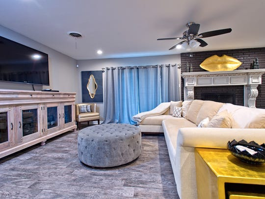The den/ TV area is the second living space in the open floor plan