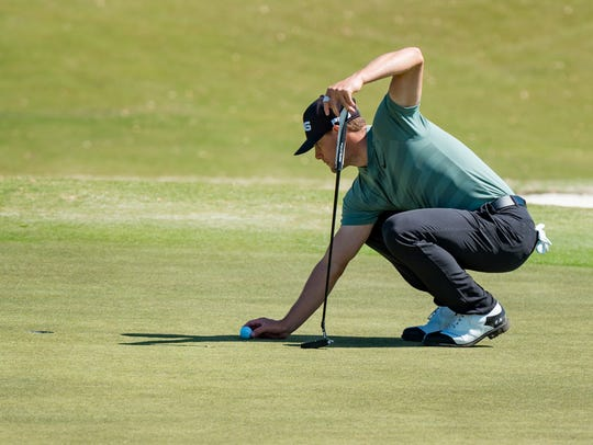 Taylor Moore lines up a putt during his round of 66 Friday to reach co-leader status with first-round leader Julian Etulain at the Chitimacha Louisiana Open at Le Triomphe.