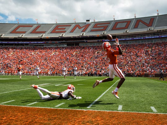 Clemson wide receiver Tee Higgins (5) evades cornerback Mark Fields (2) to catch the ball and score a touchdown during the 2018 spring football game on Saturday, April 14, 2018.